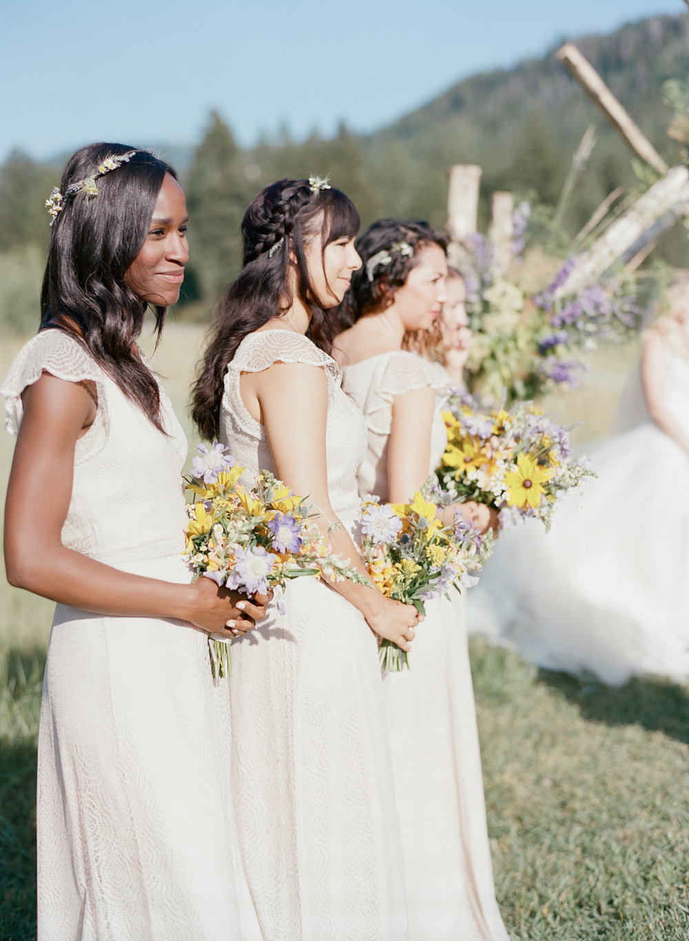 Bridal party during the ceremony with sunflower wildflower bouquets, Diverse bridesmaids, African American bridesmaid, black bridesmaid, Sylvie Gil Photography