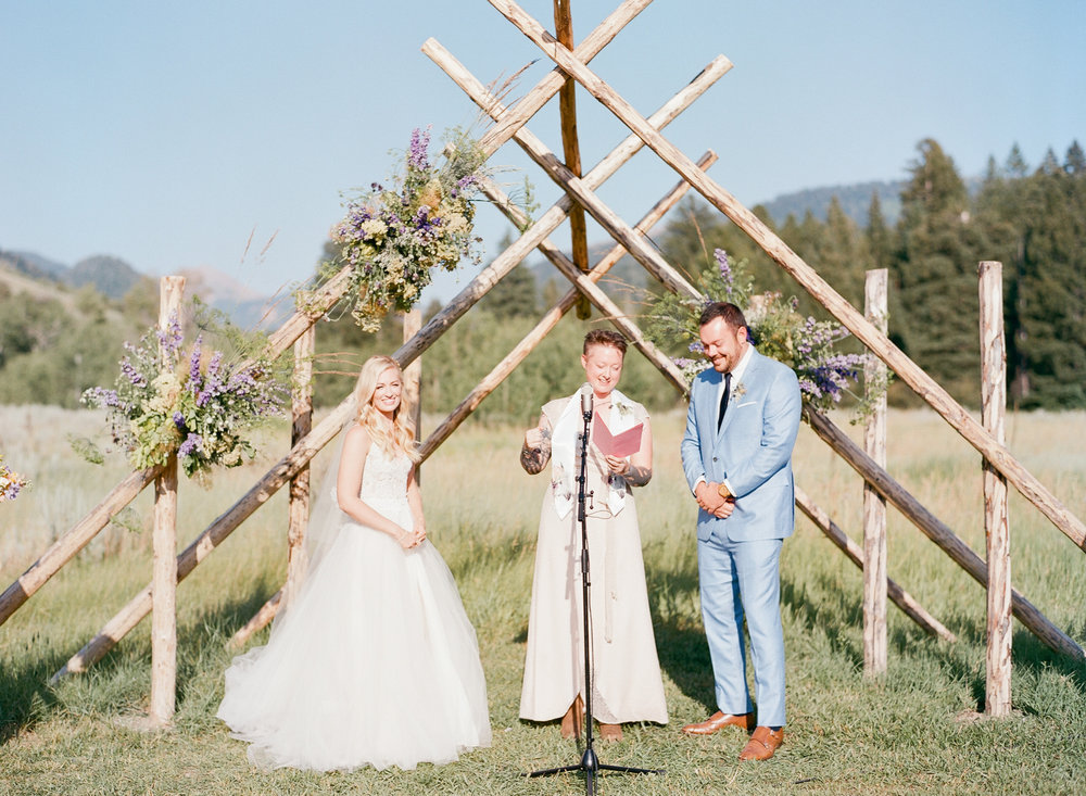 Wedding ceremony with wooden altar, hollywood couple getting married in wyoming, wilflower display, Sylvie Gil Photography