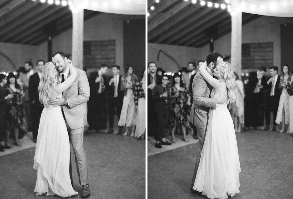 Famous couple enjoys the first dance during their barn reception for their country wedding in Wyoming, Sylvie Gil Photography