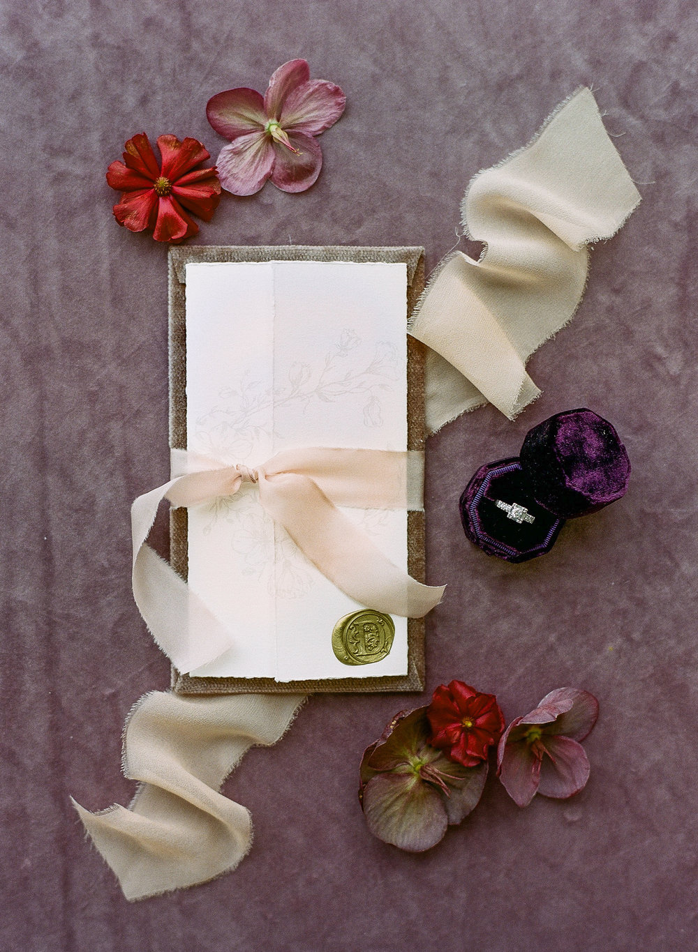 An invitation suite decorated with hellebores and rich fabrics; Sylvie Gil Photography
