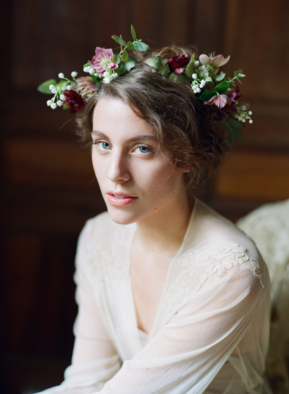 A gorgeous, moody bride with a flower crown at Chateau de Varennes in Burgundy; Sylvie Gil Photography