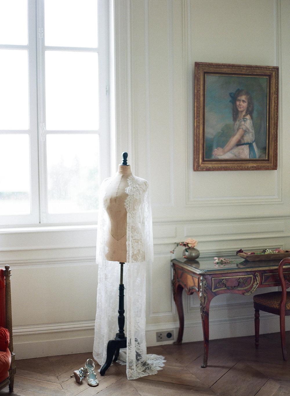A lace boudoir gown at Chateau de Varennes; Sylvie Gil Photography