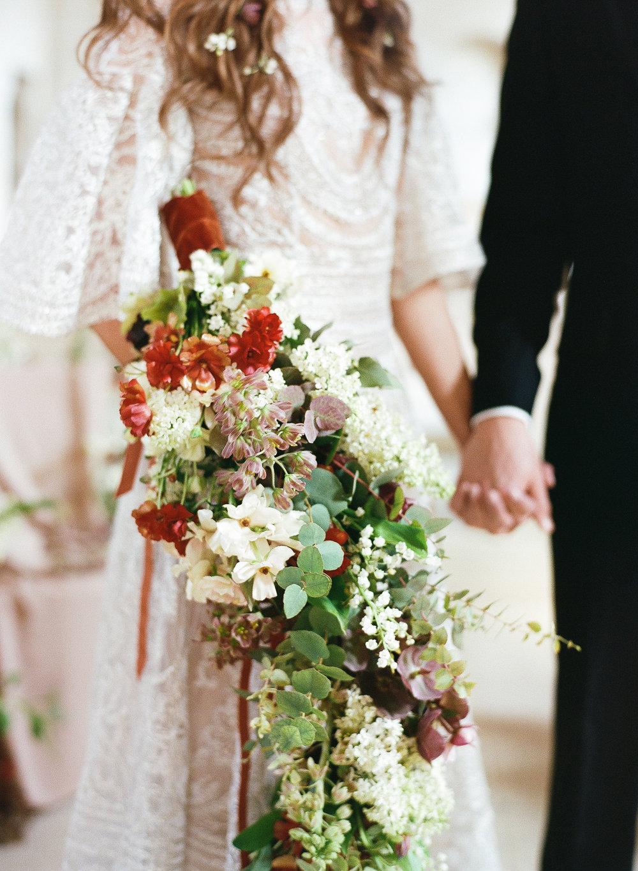 A cascading bouquet of hellebores and eucalyptus; Sylvie Gil Photography