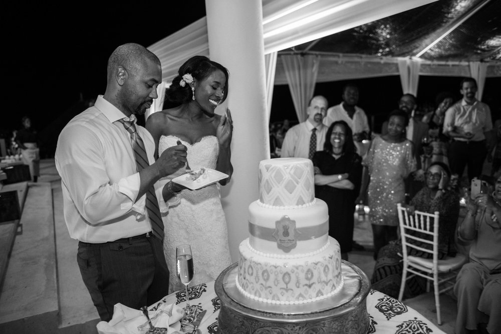 Bride and groom enjoy cake on their wedding day in Montego Bay, Jamaica; Sylvie Gil Photography