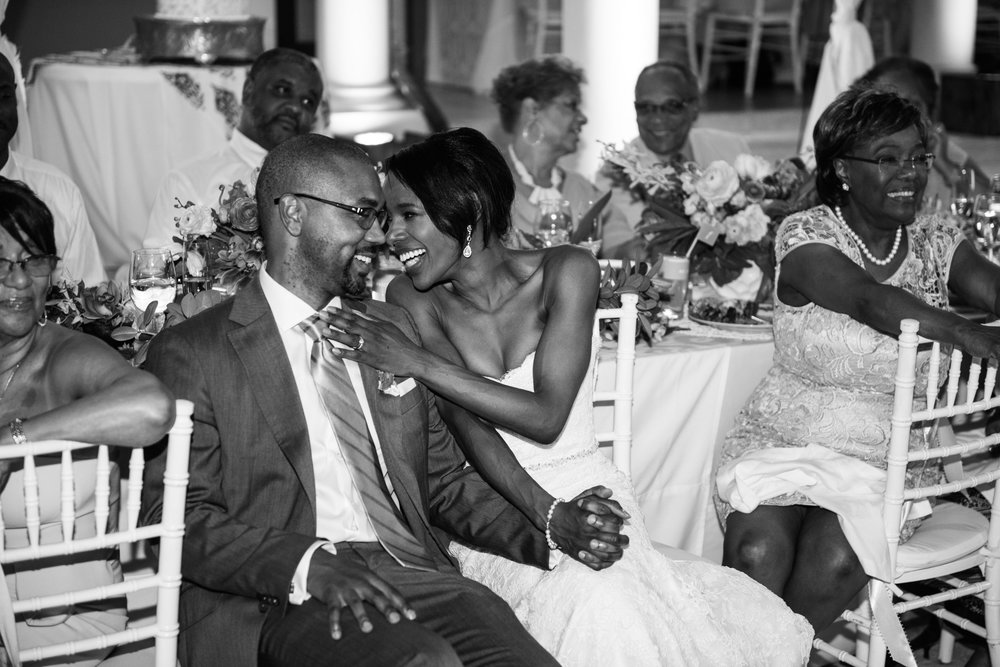 Bride and groom share a laugh during wedding toasts in Montego Bay, Jamaica; Sylvie Gil Photography