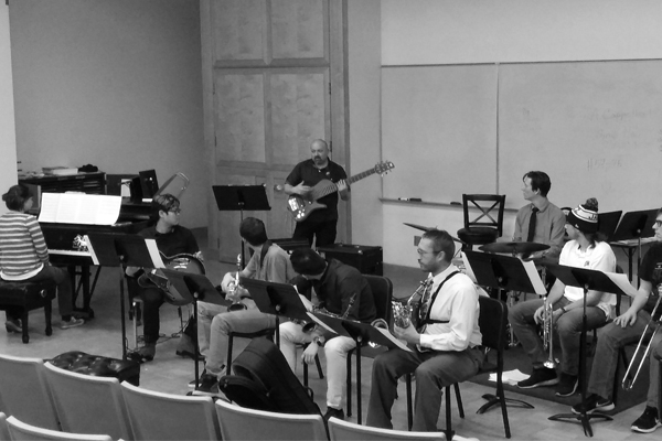 The Jazz Repertory Band rehearsing under direction of Denson Angulo shown playing the bass guitar