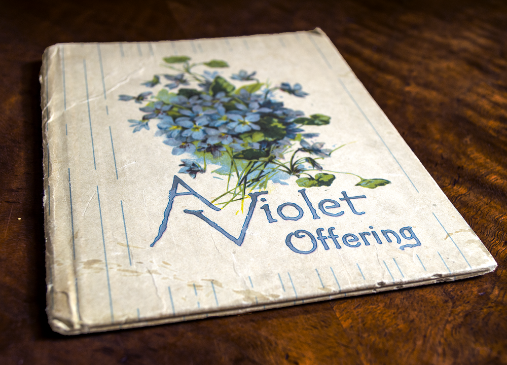 Violet poetry book from the early 1900's