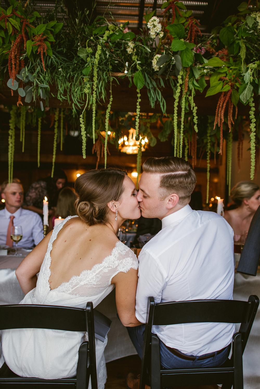 Fremont-Foundry-Dinner-Bride-and-Groom-Kiss.jpg