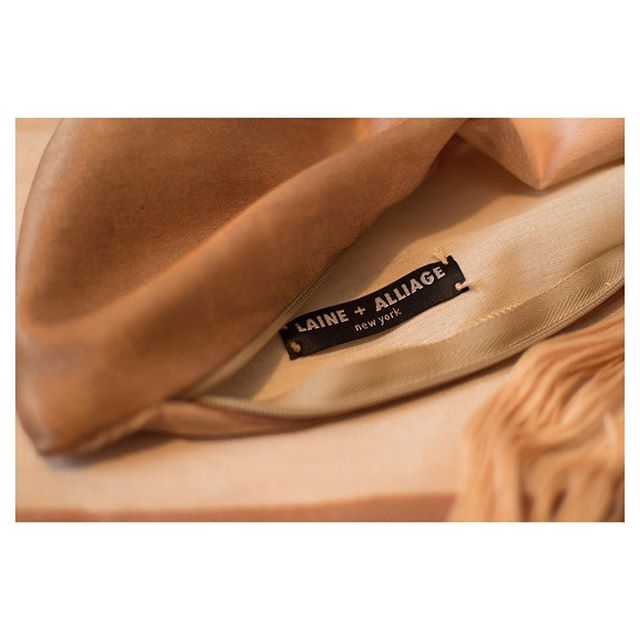 Handsewn labels are just a small part of the magic @laineandalliage . . . . . #luxuryhomes #interiordesign #interiorfabrics #womenentrepreneurs #luxury #silk #pillows #designnyc #nycdesign #smallbusiness #interiors #luxe #homedecor #handmand #parisdesign #madeinusa #bostondesign #salon #altforliving #textiles #hometextiles #interiortextiles