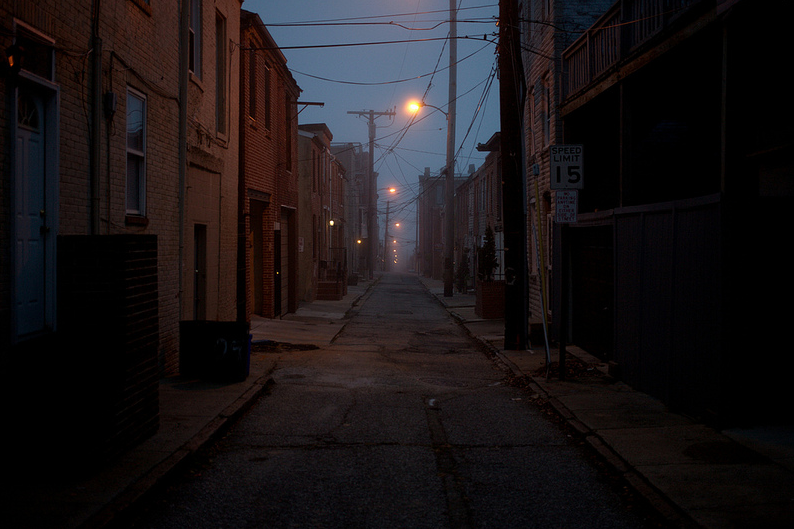 Foggy rowhouses along narrow Colonial streets in Fells Point by Patrick Joust.