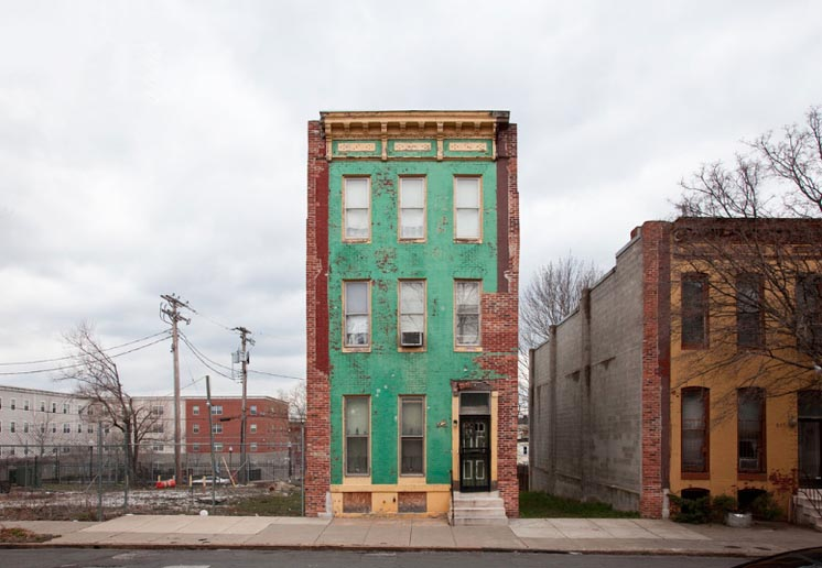A lonely Baltimore rowhouse, from Ben Marcin's series Last House Standing.