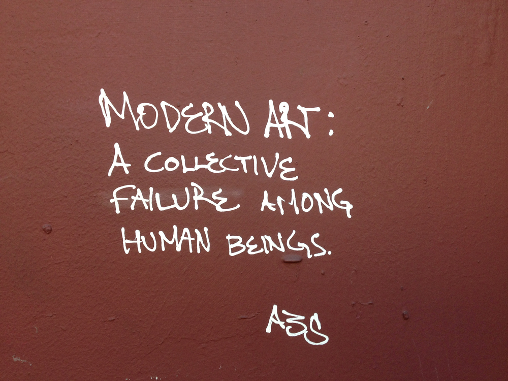 "I wonder if the wit behind this comment regards graffiti writing as ""modern art."""