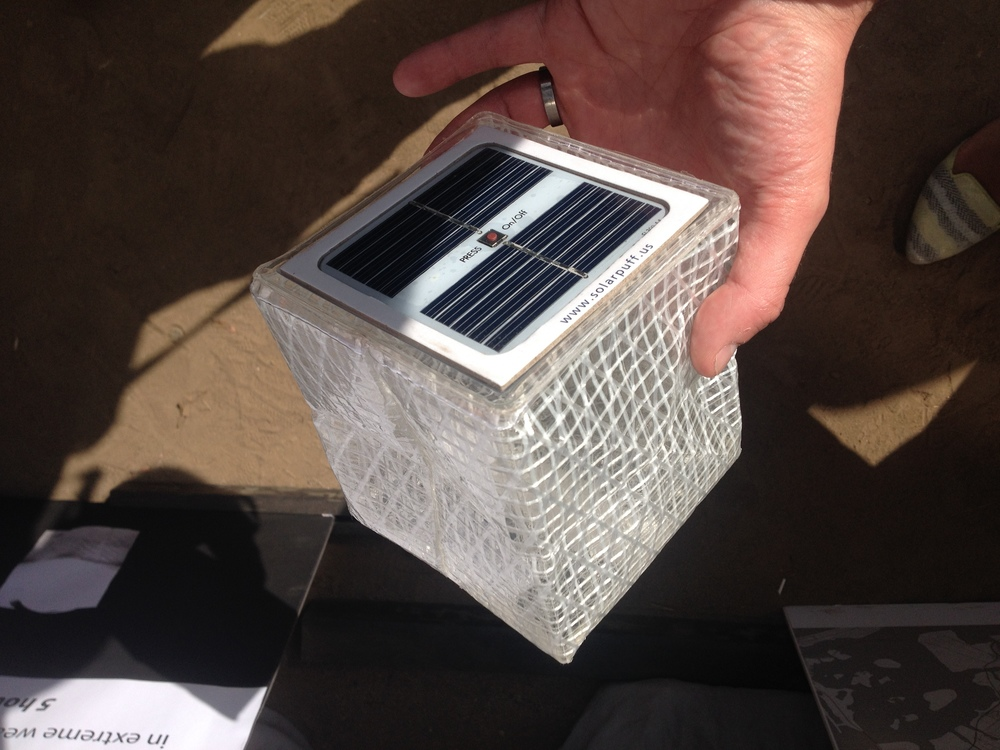 Beautiful solar-powered, flat-pack, LED lamp made from sailcloth by  Solar Puff .