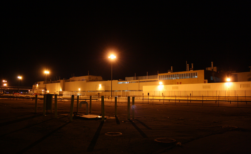 Photo of the Flint Truck and Bus Plant at night, circa 2011, by Flickr user Joseph Dennis.