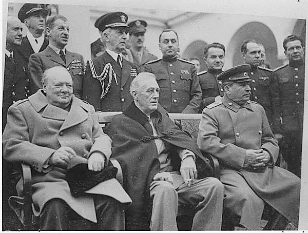 LEFT TO RIGHT: Winston Churchill, Franklin Delano Roosevelt (cigarette in hand) and Joseph Stalin, Yalta Conference, 1945.