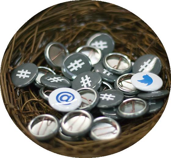 Twitter buttons at OSCON via Garrett Heath