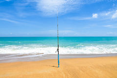 fishing-rod-empty-beach-beautiful-ocean-rod-spinning-spoon-bait-beach-fishing-rod-beach-against-horizo-74032487.jpg