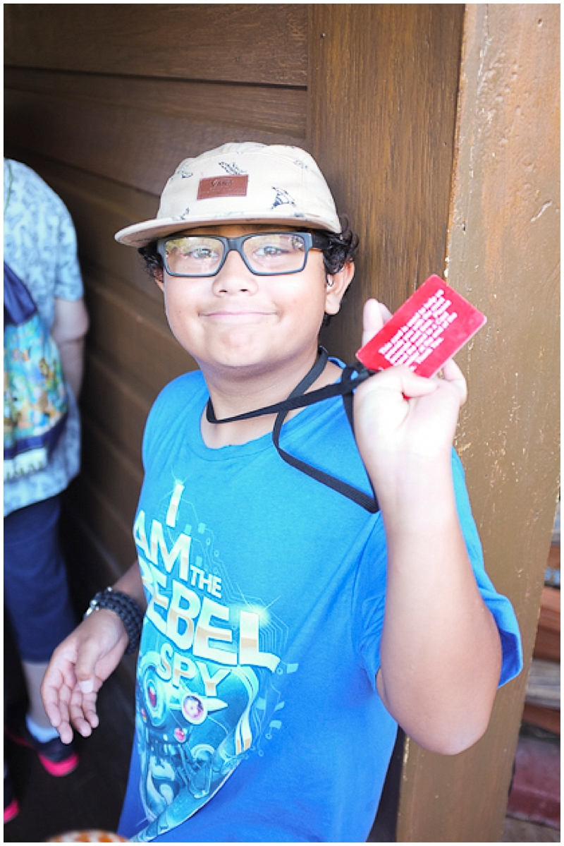 My son, being the inquisitive boy that he is, had been asking how they figured out the wait times for the rides.  Jason explained they handed out these red cards to a random person in line. Once they have the card, it starts to count how long the person is waiting until the person gets to the station, hands the card to a cast member for them to put it a machine that then tells them the length of their wait time and then this considered the wait time at the front of the ride.  You can imagine how excited he was (he's 10) when he got the red card while waiting in line for the Jungle Cruise Ride. You can also imagine how upset he was when we all realized he forgot to give the card to the cast member before getting on the ride! OOPS...