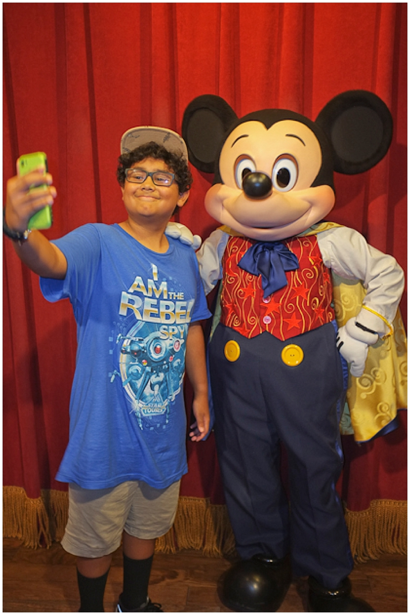 A selfie with Mickey, because why not. I love this kid!