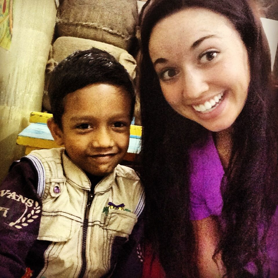 This is my new dōsta (friend) Rajul Chandra. He is 7 years old and the most adorable and happy boy! I taught him how to write and pronounce several new words today. Each time after I told him good job and gave him a high-five he'd smile and laugh and then repeat everything he'd just said to me all over again really fast! He was part of the second group we were able to work with today of kids ages 7-9. He made me hasinah (smile/laugh) a lot(: