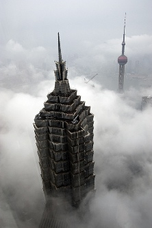 Jin Mao Tower with the Pearl Tower in background after it rained