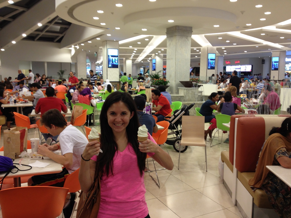 Whitney holding our much-craved ice cream cones from McDonald's.  Please note the crowded food court.