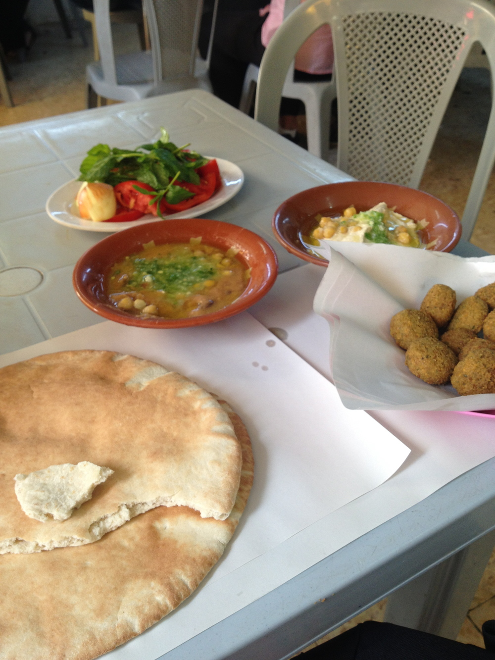 A popular restaurant in the city center named Hashem. I ate fuul, falafel, hummus, and pita.