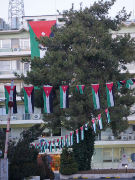 This building proudly displaying several Jordanian Flags to tourists on Rainbow Street.