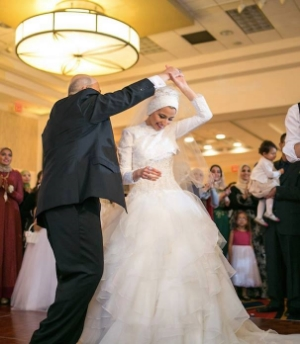 "Yuzor dancing with her father at her wedding. The photo was posted to the tribute Facebook page with the caption, ""May Allah have mercy on the bride and groom in paradise."""