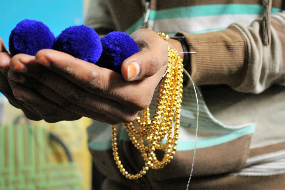 D'Chica- This jewelry making course is offered to women and girls with little education to learn a new skill while earning a small income