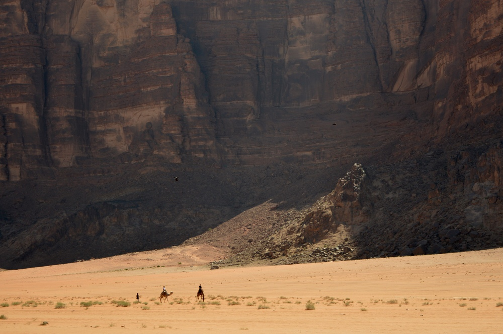 Another one of my favorite photos from Wadi Rum. Here a Bedouin man (in the back) leads two travelers on the backs of camels.