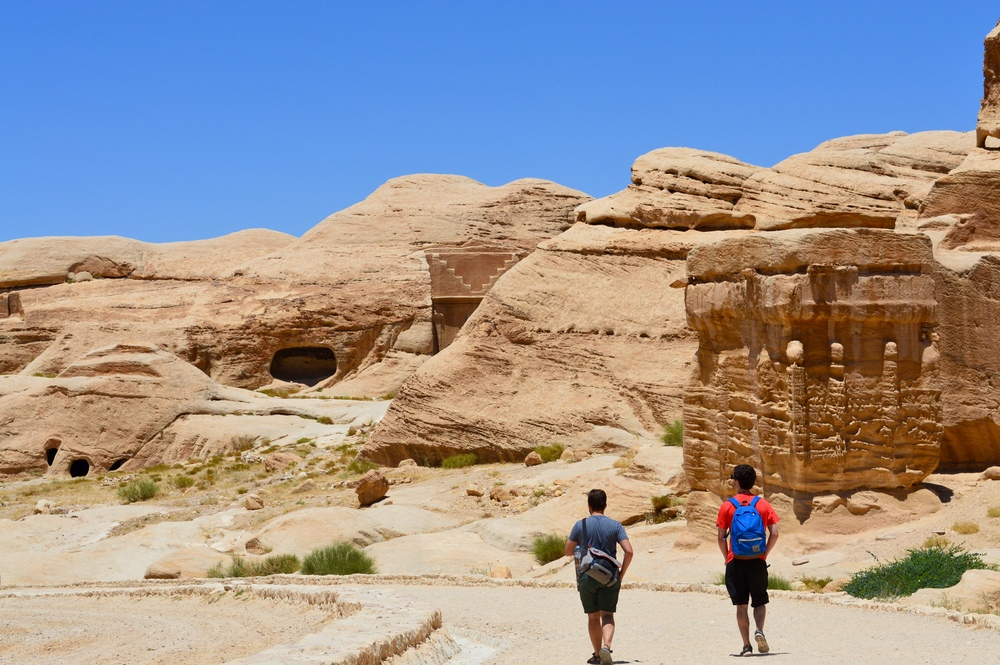 The entrance to Petra. Archaeologists are unsure of the purpose of the large block structure on the right. The Bedouin tradition says that it is to ward of the Jin, the servants of the devil.