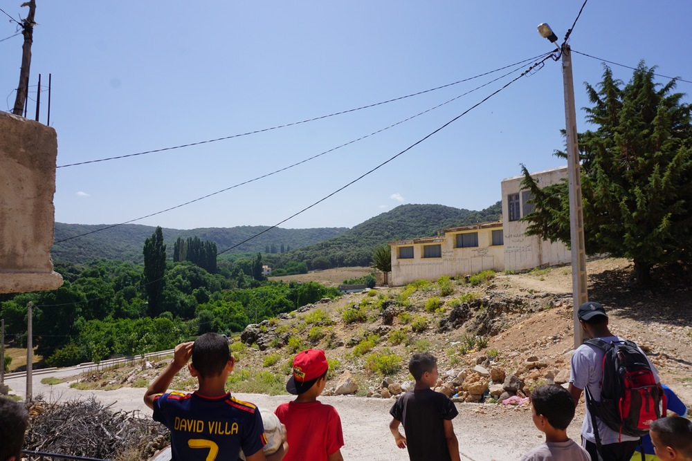 Leaving the center, dodging sheep poop on the way to the trail.  The building straight ahead is the school, where children up to 6th grade attend.  The students learn Tamazight, the native Berber dialect, as well as Arabic and French.
