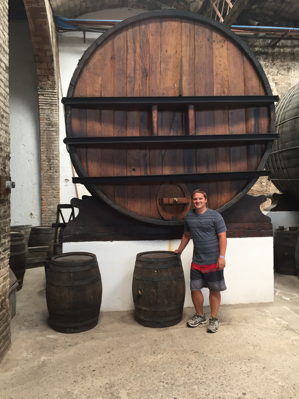 One of the massive vats they used to use to store their wine. And I'm not sure who the guy is.