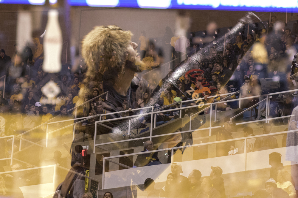 Mountaineer Michael Garcia fires a t-shirt into the stands before the game.