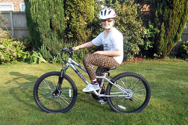 Amber on her Apollo Krypt Girls Mountain Bike from Halfords