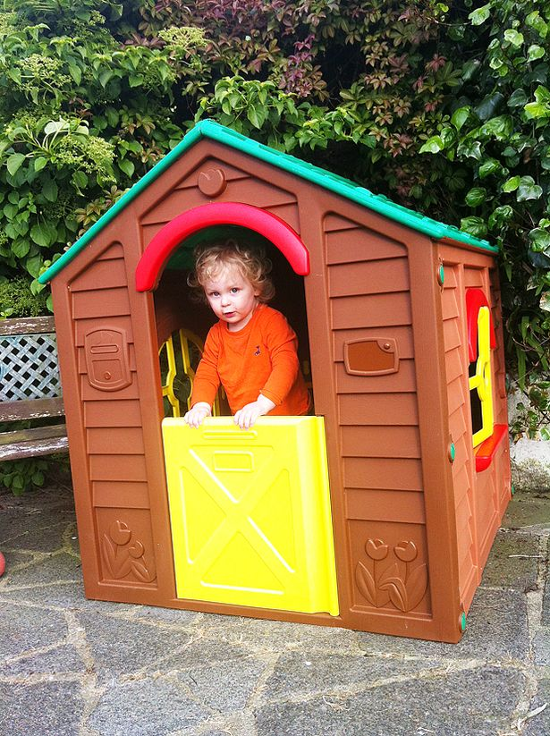 Jacob playing in his playhouse from Keter