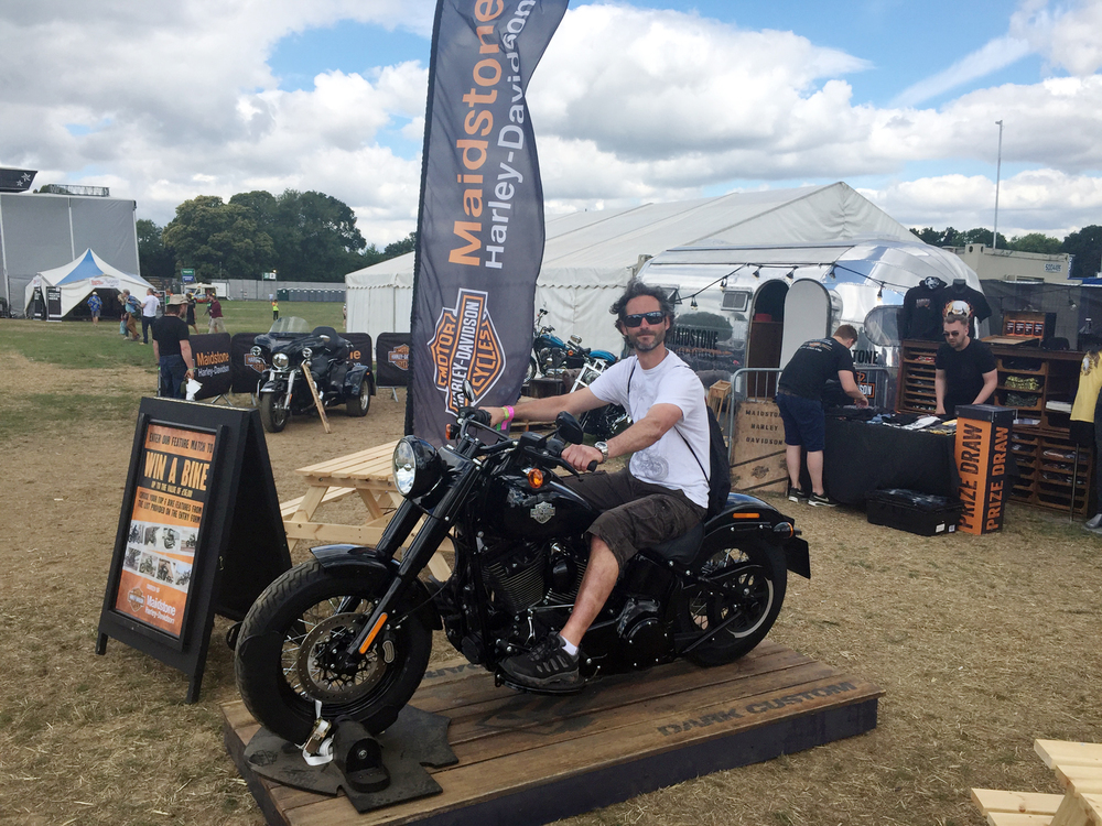 Andy sat on a Harley at Ramblin' Man Fair