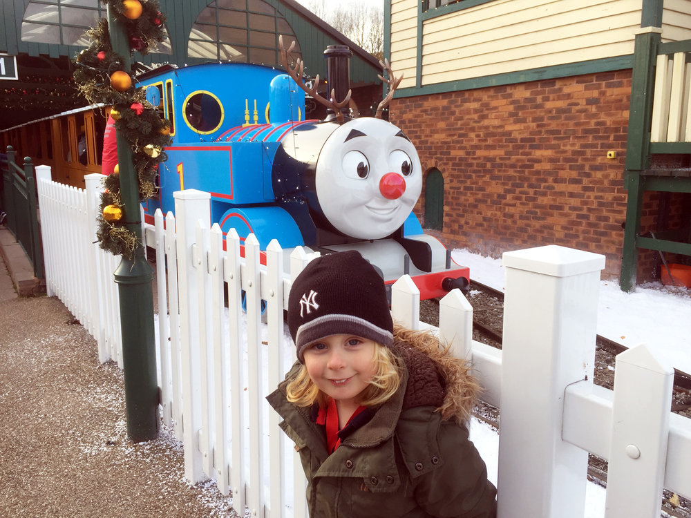 Jacob meeting a festive Thomas the Tank Engine