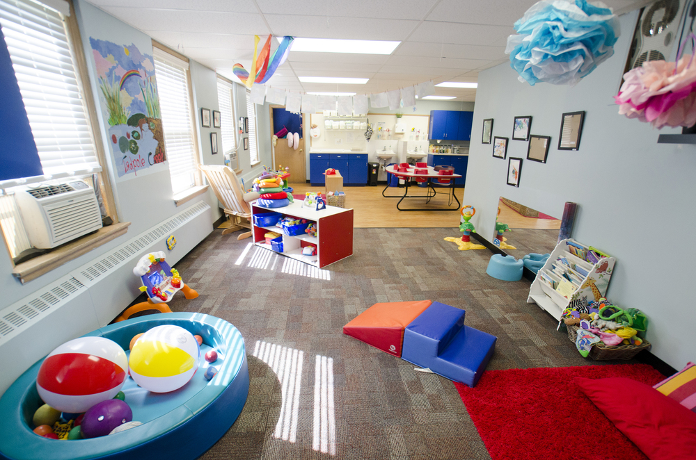 The infant room includes distinct areas for eating, exploring and sleeping.