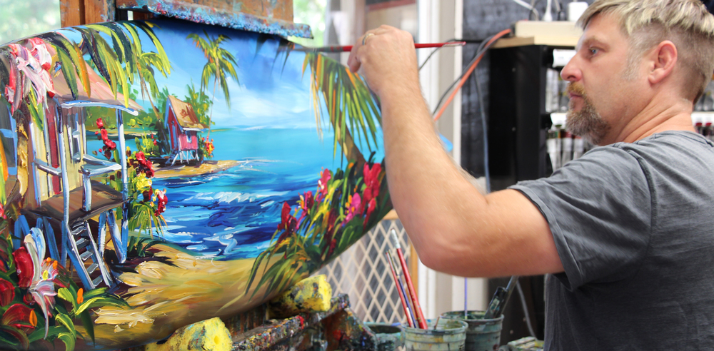 Oceanside local, Steve Barton, creates a gorgeous tropical oil painting on a surfboard.