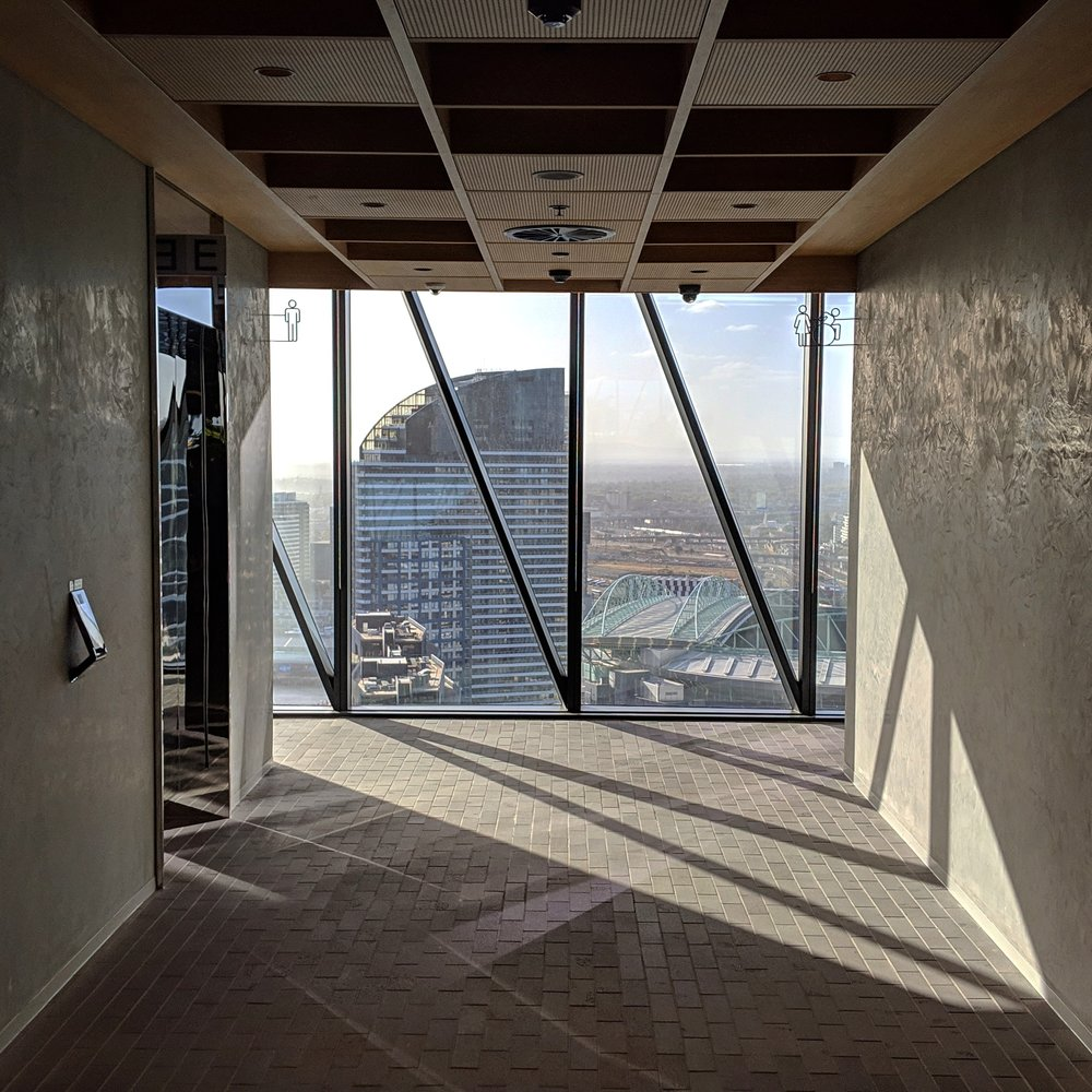 Looking out the full-height windows on the 30th floor at Collins Square in Docklands, Melbourne