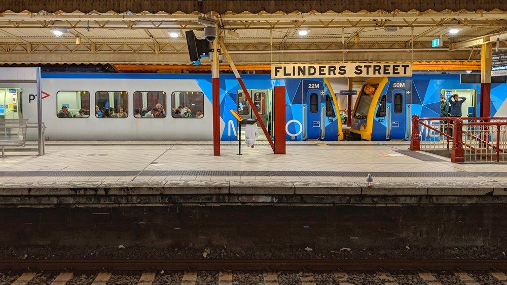 Waiting on a mostly empty platform at Flinders Street station.