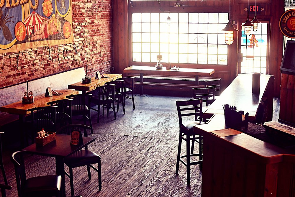 The Lounge - DJ Booth / Extension of Bootleg / Drop ScreensThe Lounge, a semi-private space on our main dining rooms floor, offers a raise platform with tables and banquettes that can be reserved for larger group lunch and dinner reservations. Features include a DJ booth with complete nightclub sound, lighting effects, and two large drop-down video screens with ful HDMI display, suitable for dance parties, large format sports viewing parties, and corporate presentation. A dedicated full bar and stainless counter outfitted for buffet food service round our the amenities included in this relaxed space. CAPACITY:  Standing- 100  Seated- 60