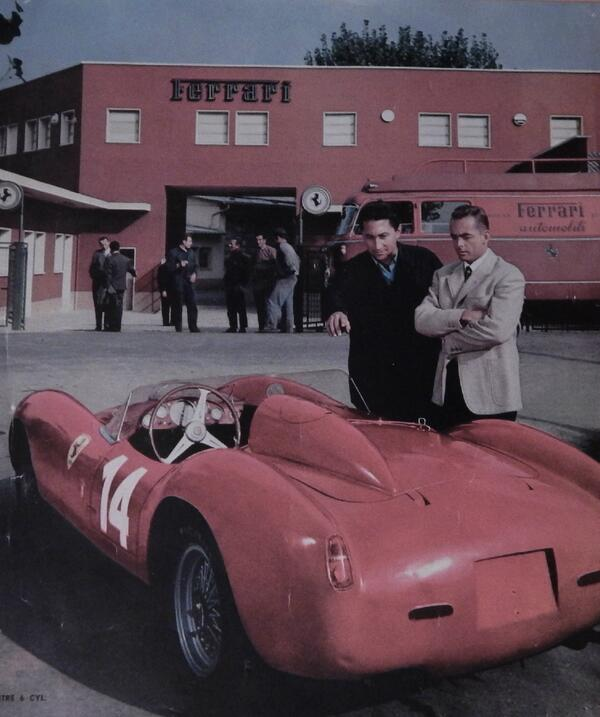 A very sharp-dressed Phil Hill admiring an equally sharp-dressed Ferrari.jpg