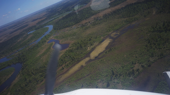 In Flight up the Nushagak River. You can see the prop in the picture on the left.