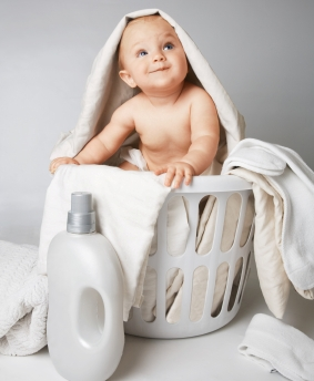 baby in laundry basket.jpg