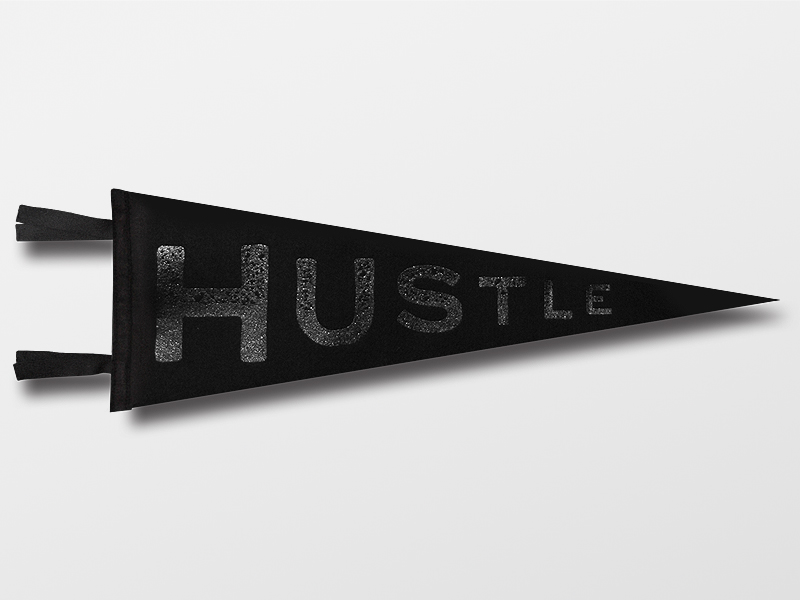 Hustle Pennant  All Black Everything      $20.00    Material: Wool Felt Size: 9'' x 27'' Colors: Black, Black, Black, and Gloss Black Detail: Custom  black and metallic gold  embroidered label on back   Click below to purchase from Oxford Pennant.