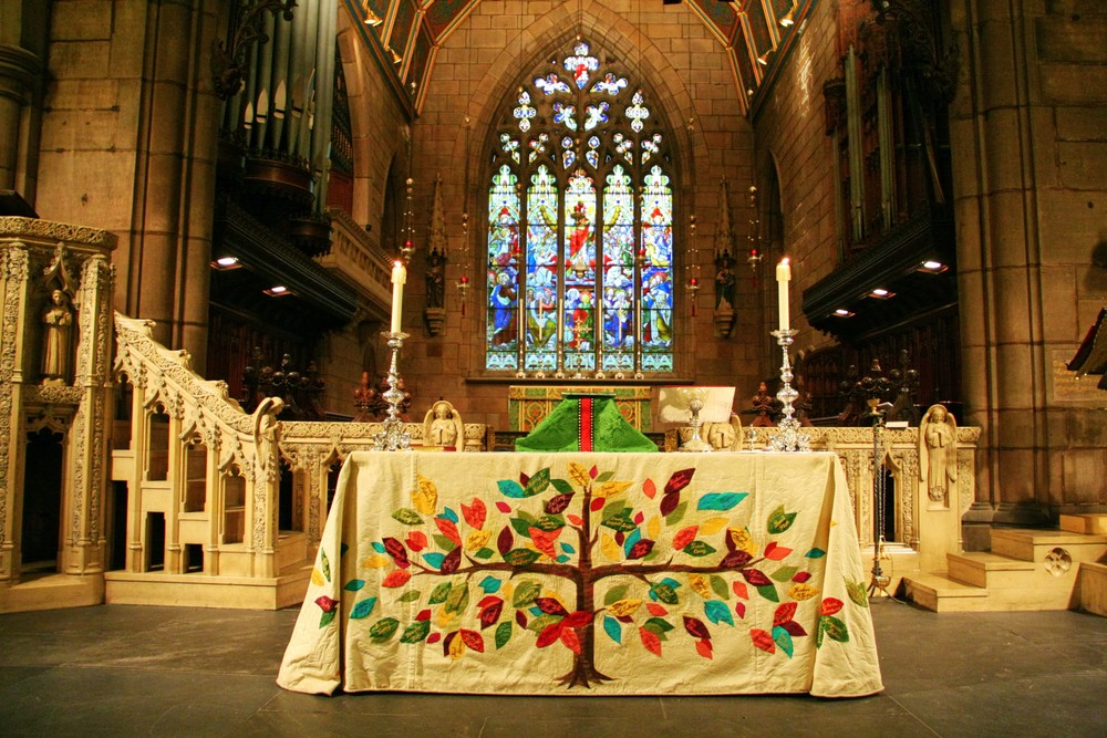 The free-standing Altar prepared for the Family Mass, vested in the AIDS memorial frontal.