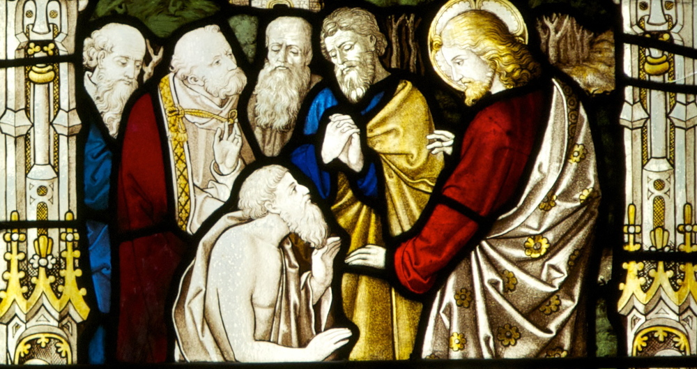 Detail from a stained glass window in the church showing scenes of Christ's healing miracles.